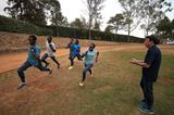 IAAF President Sebastian Coe watches as athletes train at the refugee camp in Ngong (Getty Images)