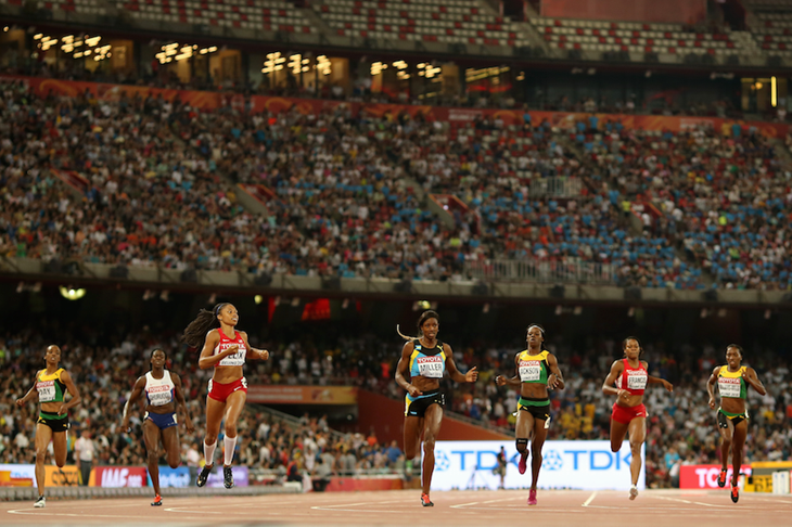Athletes crossing the finish line in the women's 400m at the Beijing World Champs ()