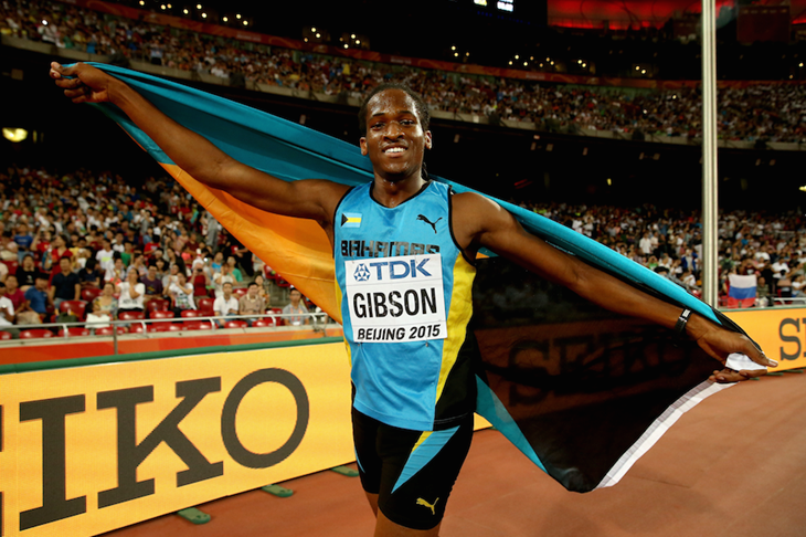 Jeffery Gibson celebrates at the Beijing World Championships ()