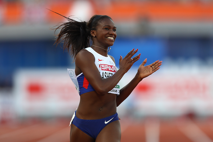 Dina Asher-Smith celebrates winning the 200m at the European Championships ()