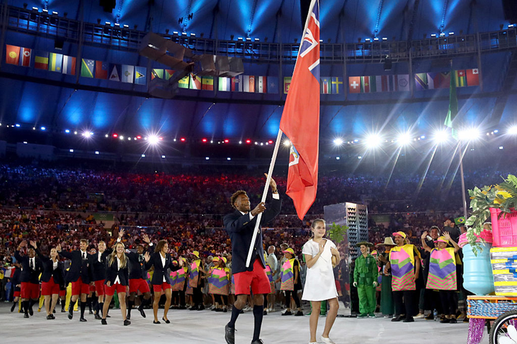 Tyrone Smith carries the Bermudian flag during the 2016 Rio Olympics (Getty Images)