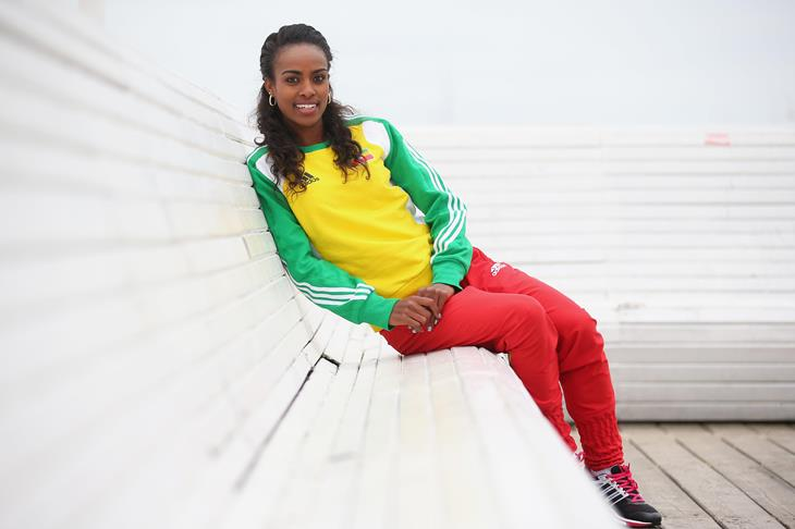 Genzebe Dibaba sitting on a bench on the  pier ahead of Sopot 2014 ()