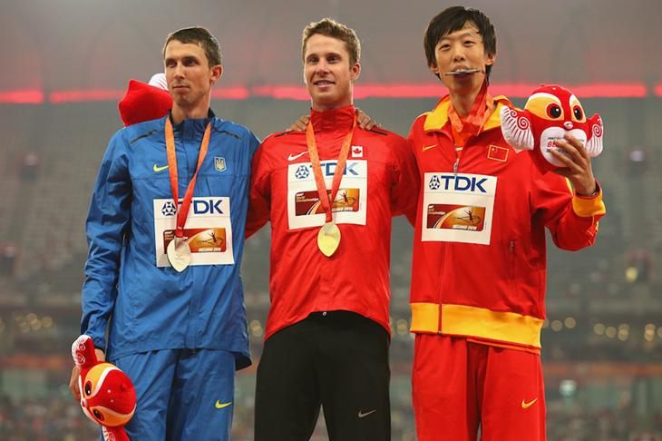High jump medallists Bondarenko, Drouin and Zhang in Beijing ()