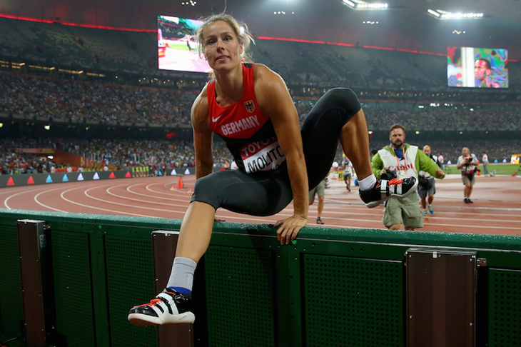 Katharina Molitor hurdles the barrier after winning the world title ()