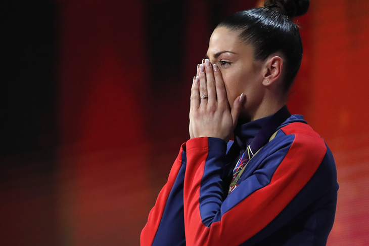 Ivana Spanovic gets emotional on the podium after winning long jump gold at the World Indoors in Birmingham ()