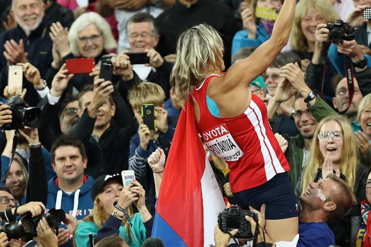 Barbora Spotakova celebrates in the crowd (Getty Images)