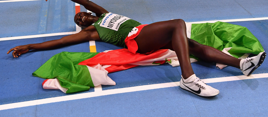 Francine Niyonsaba collapses in delight after successfully defending her 800m title at the IAAF World Indoor Championships Birmingham 2018 ()