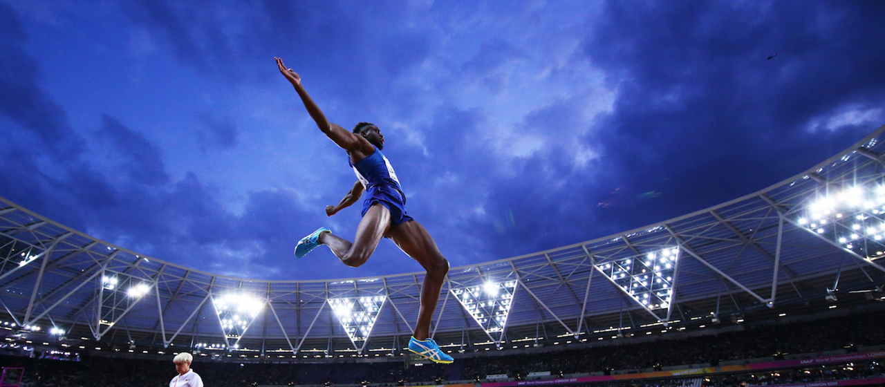 Jarrion Lawson mid flight during the long jump (Getty Images)