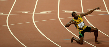 Usain Bolt celebrates his 200m win at the 2015 Beijing World Championships (Getty Images)