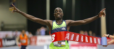 Edward Cheserek breaks the tape at the 2018 New Balance Indoor Grand Prix (A Runner's Eye)